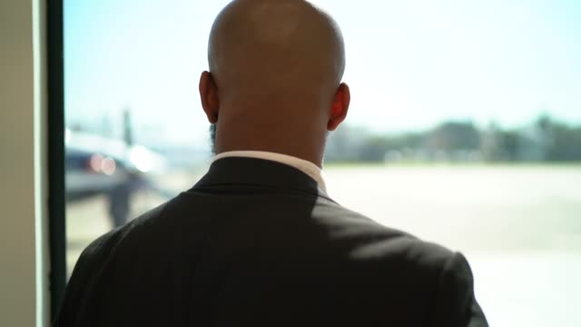 rear view of businessman looking away through window - afro stock videos & royalty-free footage
