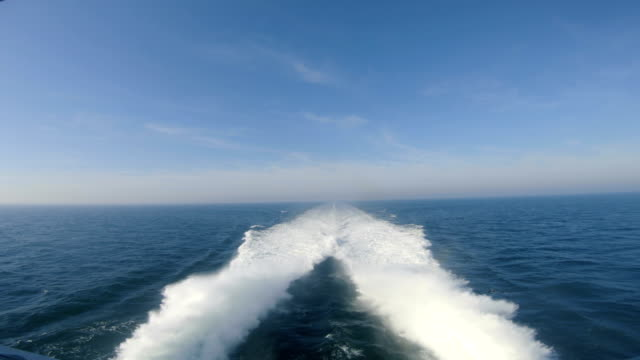 rear view of catamaran ferry sailing across the sea with high speed - nautical vessel stock videos & royalty-free footage