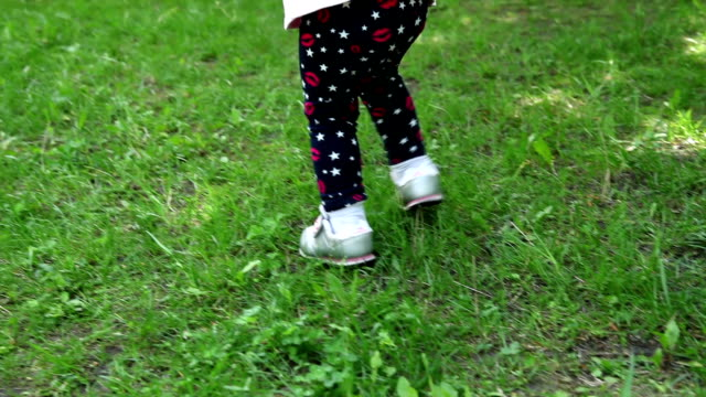 rear view of child walking with hands behind back - hands behind back stock videos and b-roll footage