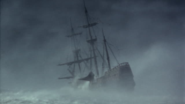 rear view of clipper ship capsizing during storm / plymouth adventure (1952) - wrack stock-videos und b-roll-filmmaterial