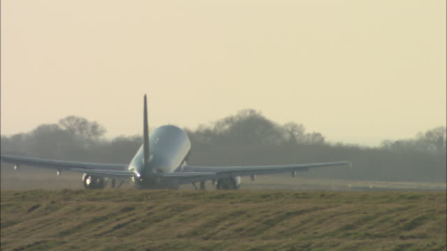 WS Rear view of commercial jet taking off, Belfast Airport, Ireland, United Kingdom