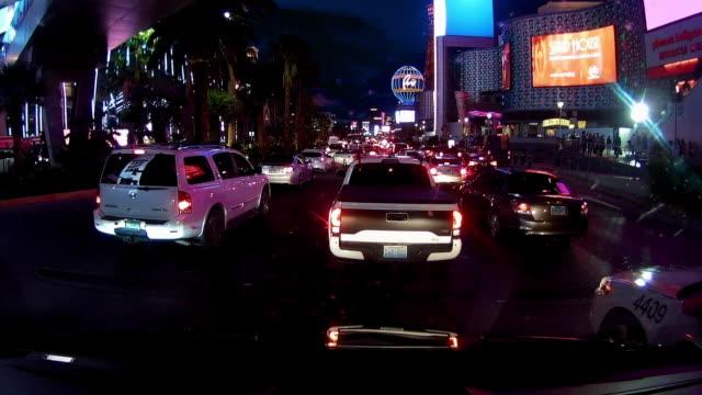 rear view of driving in las vegas at night - the strip las vegas stock videos & royalty-free footage