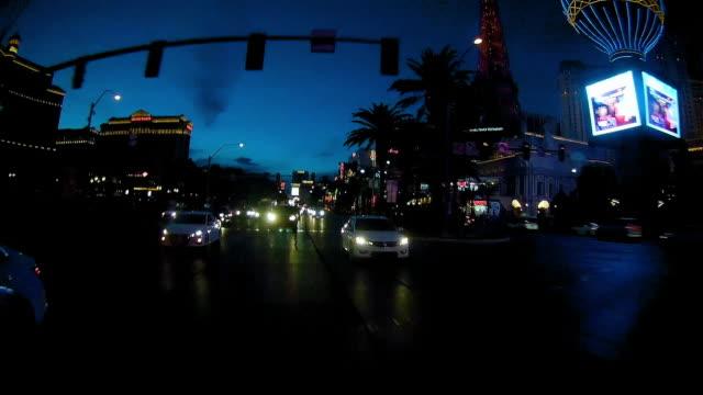 rear view of driving in las vegas at night - replica della torre eiffel di las vegas video stock e b–roll