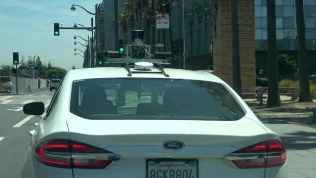 rear view of experimental self driving car with lidar sensors visible in the mission bay neighborhood of san francisco california june 10 2019 - driverless transport stock videos & royalty-free footage