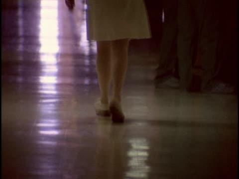 1978, WS TU Rear view of female nurse dancing in hospital corridor, Los Angeles, California, USA