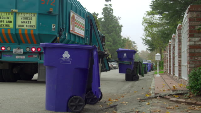 ms rear view of  garbage truck picking up garbage bins, north hollywood, california, usa - garbage truck stock videos and b-roll footage