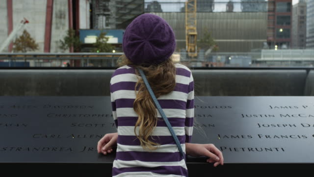 ms rear view of girl leaning on edge of september 11 2001 memorial / manhattan, new york city, new york state, usa - 2001 stock videos and b-roll footage