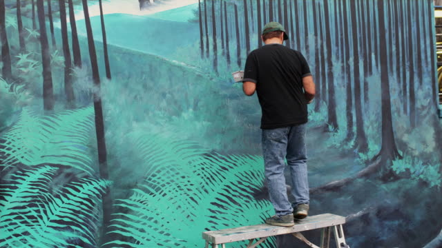 ws rear view of local artist working on outdoor mural / portland, oregon, usa - painting stock videos & royalty-free footage