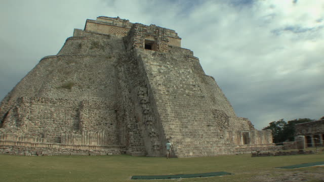 ws rear view of man climbing adivino (pyramid of magician) at pre-columbian ruined city of maya civilization / uxmal, yucatan, mexico - pre columbian stock videos & royalty-free footage