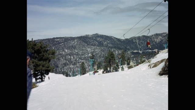 rear view of man skiing at ski resort, usa - ski lift stock videos & royalty-free footage