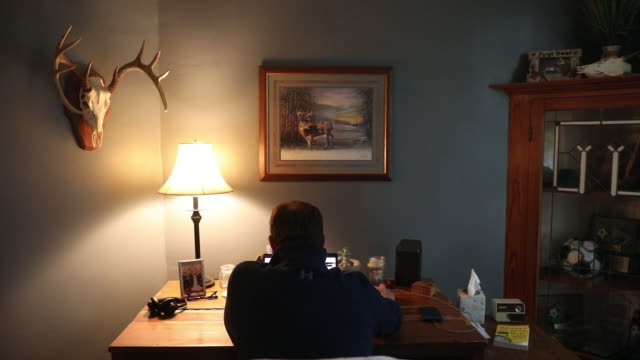 rear view of man working from home amid coronavirus pandemic in princeton, il, u.s. on friday, september 11, 2020. - using laptop stock videos & royalty-free footage
