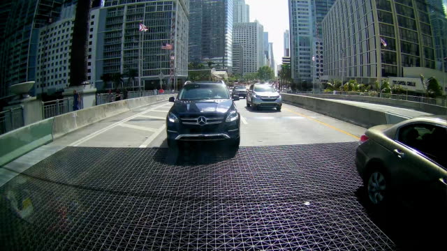 rear view of mercedesbenz car driving in miami - mercedes benz stock videos & royalty-free footage
