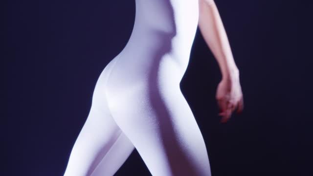 stockvideo's en b-roll-footage met rear view of mixed race woman dancing in white unitard - gympak