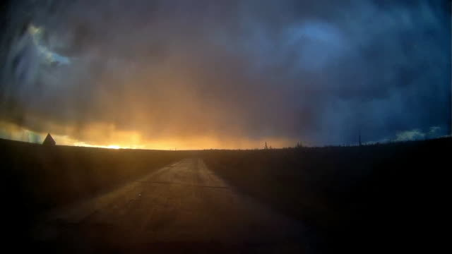 rear view of moody glowing sunset after rainstorm at arctic circle area - vanishing point stock videos & royalty-free footage