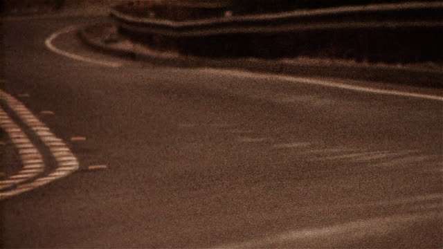 stockvideo's en b-roll-footage met rear view of motorcycle rounding bend - cross processen