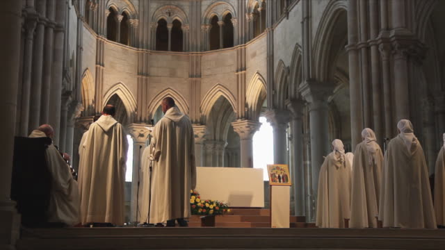 ws rear view of nuns and monks of fraternity of jerusalem singing daily liturgy in basilica of saint mary magdalene / vezelay, france - gothic stock videos & royalty-free footage