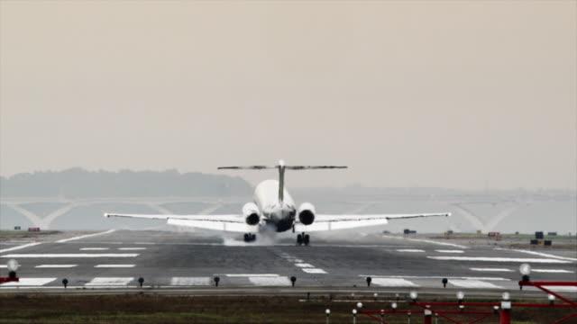 SLO MO WS Rear view of passenger airplane landing on Ronald Reagan Washington National Airport / Washington DC, USA