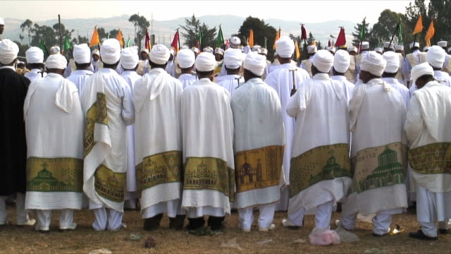 stockvideo's en b-roll-footage met ms rear view of priests and procession of timka, ethiopian orthodox celebration of epiphany, addis ababa, ethiopia - christendom