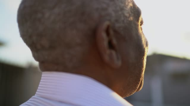 rear view of senior man walking and looking away while thinking about life - hope stock videos & royalty-free footage