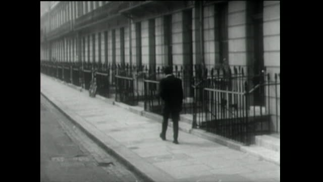 rear view of teddy boy walking down residential street; 1955 - nostalgia stock videos & royalty-free footage