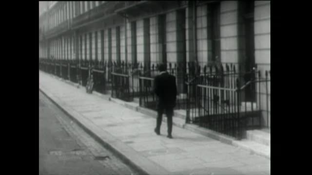 rear view of teddy boy walking down residential street; 1955 - memorial stock videos & royalty-free footage
