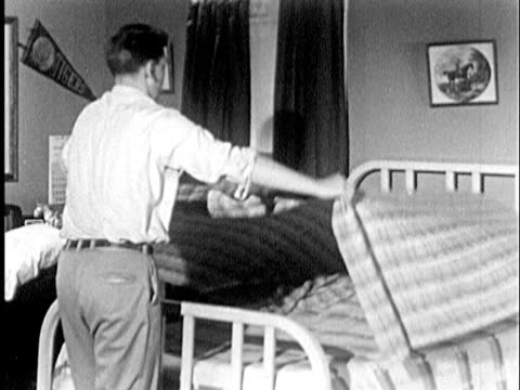 b/w ms 1951 rear view of teenage boy making bed / usa - one teenage boy only stock videos & royalty-free footage