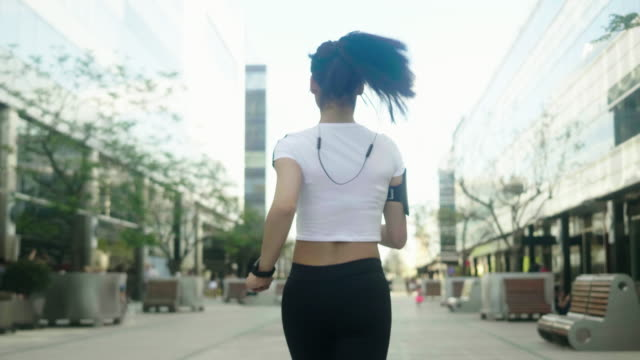 rear view of the runner in the city - ponytail stock videos & royalty-free footage