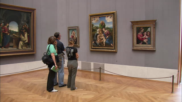 ws rear view of three people looking at raphael's paintings in alte pinakothek, munich, bavaria, germany - museum stock videos & royalty-free footage