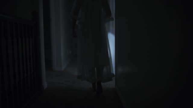 rear view of woman in nightgown investigating home with flashlight at night / springville, utah, united states - spooky stock videos & royalty-free footage