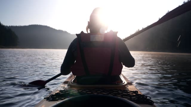 rear view of woman kayaking - oar stock videos & royalty-free footage