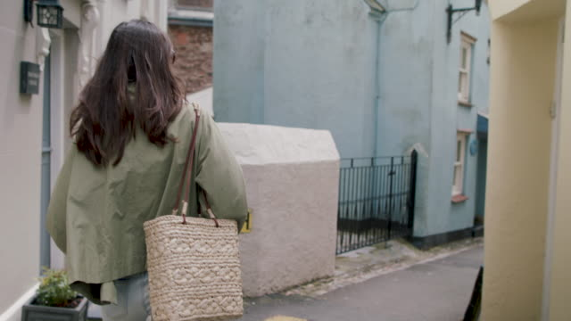 rear view of woman walking - kingsand video stock e b–roll