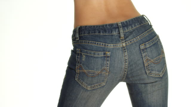 rear view of woman wearing denim jeans - belly button stock videos and b-roll footage