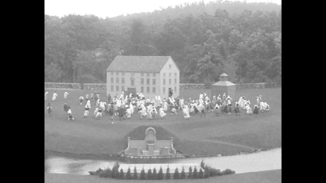 ls rear view of women in american colonial period costume watch a man on platform in distance they drop to their knees in prayer / mls reverse angle... - lexington massachusetts stock videos & royalty-free footage