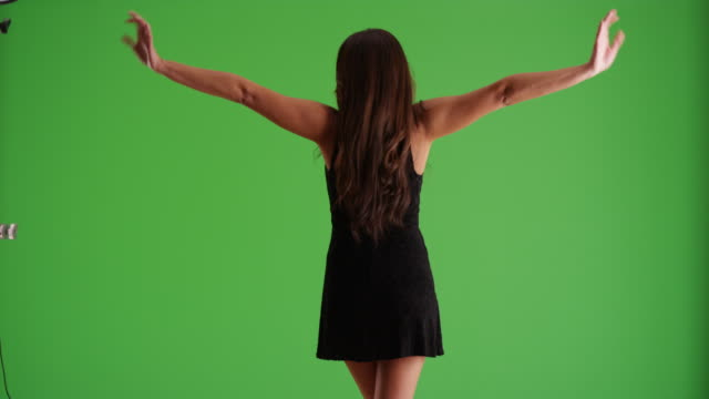 rear view of young latina female in sexy black dress dancing on green screen - black dress stock videos & royalty-free footage