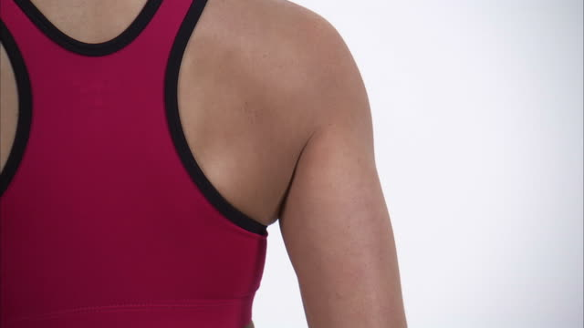 cu td rear view of young woman in sports bra, mid section / orem, utah, usa - sports bra stock videos & royalty-free footage