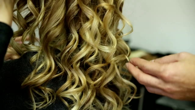 rear view of young woman with long curly hair - curly stock videos & royalty-free footage