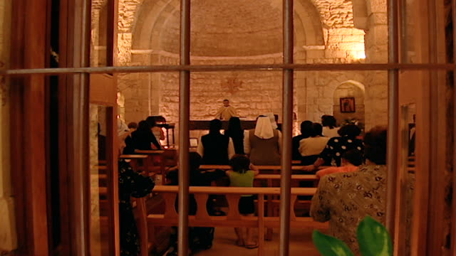 rear view through a window of a maronite catholic mass in arabic at the church of the kfifan monastery. - christianity stock videos & royalty-free footage