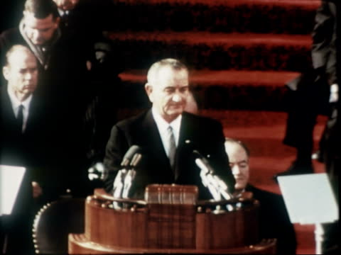rear view us president lyndon baines johnson delivering inaugural address outside us capitol building / president lyndon johnson speaking vice... - vice president stock videos & royalty-free footage