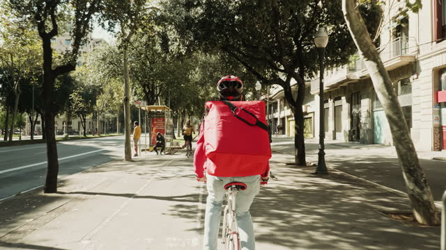 rear view video of young man city bike courier - yellow taxi stock videos & royalty-free footage