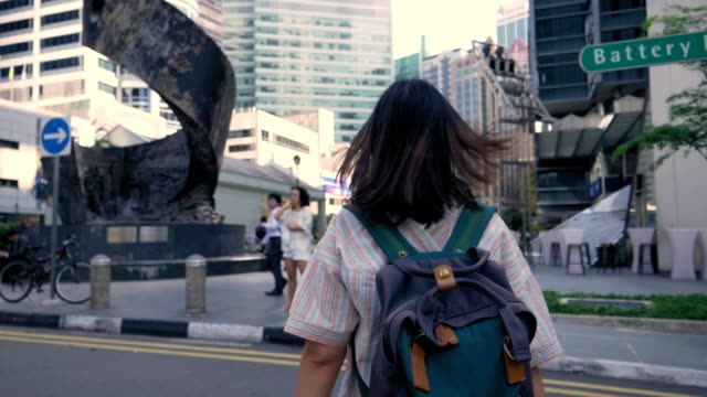 Rear view : Women walking in singapore city