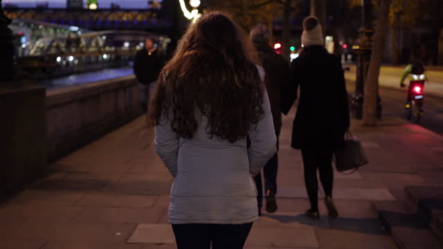 rear view young woman walking alone in london. - homelessness stock videos & royalty-free footage