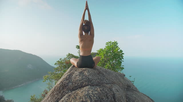 rear view,happy of young women age 29 yearold of latin american and hispanic ethnicity doing practice yoga on the top of mountain ocean summit.happiness in nature concept. - wonderlust stock videos & royalty-free footage