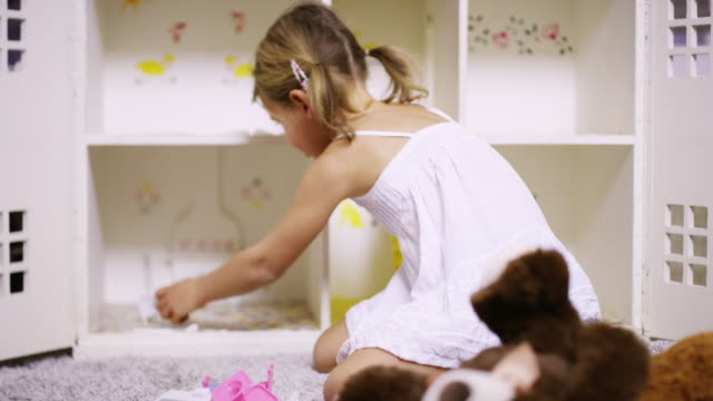 rearranging the furniture in her doll's house - doll stock videos & royalty-free footage