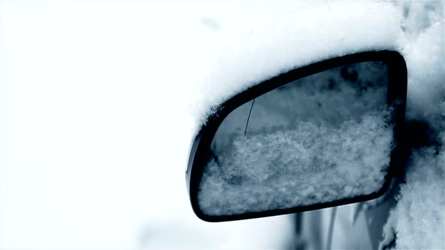 rear-view mirror on the car covered with snow,close up