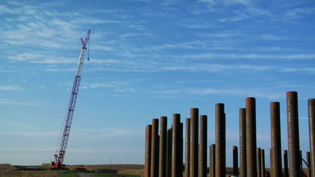 ms rebar in construction frame at rural site with crane in background/ kewaunee, illinois - rod stock videos and b-roll footage