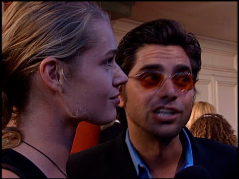 stockvideo's en b-roll-footage met rebecca romijn at the 'love stinks' premiere at the mann village theatre in westwood california on august 11 1999 - rebecca romijn