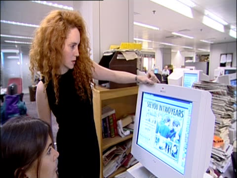 rebekah brooks oversees the front page layout of the news of the world newspaper; 2001 - news of the world stock-videos und b-roll-filmmaterial
