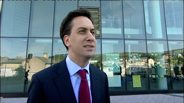 ed miliband interview and school visit england lancashire rochdale darwen ext ed miliband towards along road with assistant ed miliband mp interview... - ed miliband stock-videos und b-roll-filmmaterial