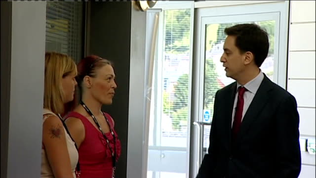 ed miliband interview and school visit int ed milband shaking hands with school teachers and staff in school reception area/ ed miliband handshake... - ed miliband stock-videos und b-roll-filmmaterial