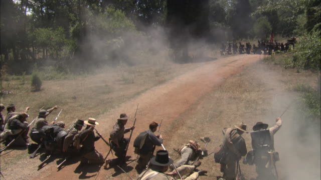 rebel and union armies battle on a dirt road during the civil war. - reenactment stock videos & royalty-free footage
